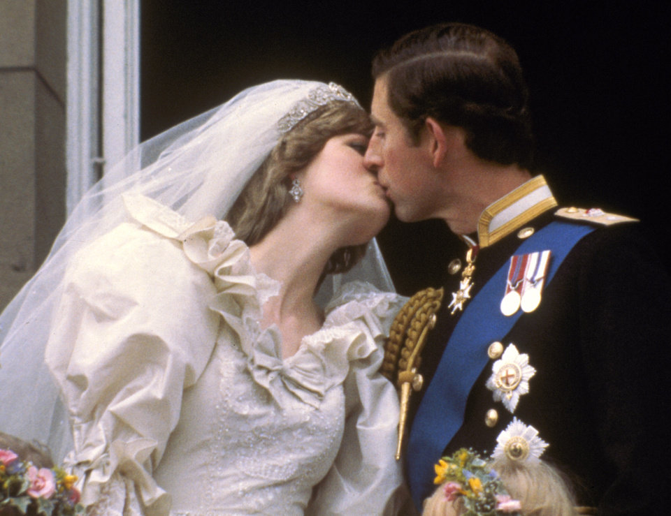 FILE - In this July 29, 1981 file photo, Britain's Prince Charles kisses his bride, the former Diana Spencer, on the balcony of Buckingham Palace in London, after their wedding.  Sony Electronics and the Nielsen television research company collaborated on a survey ranking TV's most memorable moments. Other TV events include, the Sept. 11 attacks in 2001, Hurricane Katrina in 2005, the O.J. Simpson murder trial verdict in 1995 and the death of Osama bin Laden in 2011. (AP Photo, file) ORG XMIT: NYET133