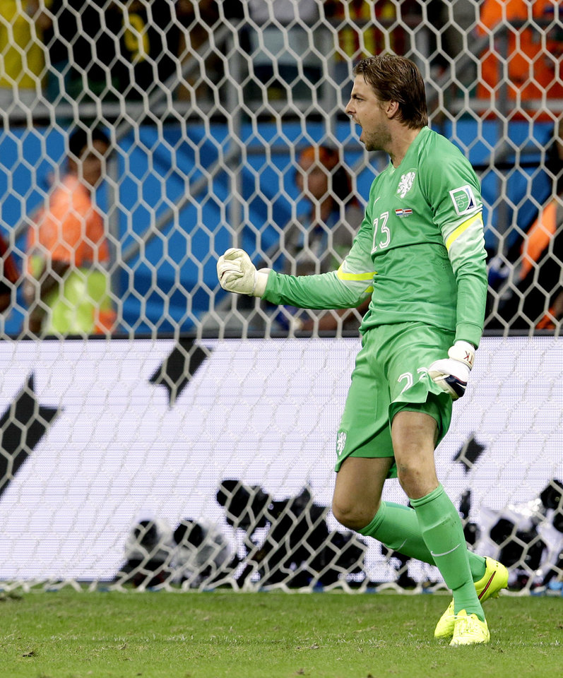 Photo - Netherlands' goalkeeper Tim Krul celebrates after saving a penalty during penalty kicks of  the World Cup quarterfinal soccer match between the Netherlands and Costa Rica at the Arena Fonte Nova in Salvador, Brazil, Saturday, July 5, 2014. (AP Photo/Hassan Ammar)
