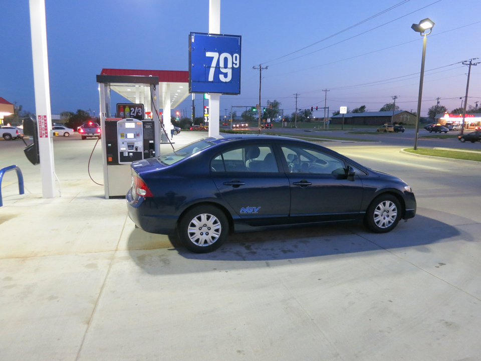 Adam Wilmoth?s recently purchased CNG-powered Honda Civic is shown at a local fuel station, filling up for about 80 cents a gallon. PHOTO BY ADAM WILMOTH, THE OKLAHOMAN <strong></strong>