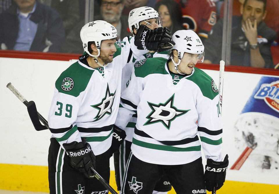 Photo - Dallas Stars' Ryan Garbutt, right, celebrates his goal with teammate Travis Morin during second-period NHL hockey game action agaisnt the Calgary Flames in Calgary, Alberta, Thursday, Nov. 14, 2013. (AP Photo/The Canadian Press, Jeff McIntosh)