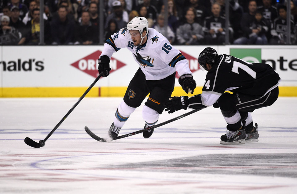 Photo - San Jose Sharks left wing James Sheppard, left, is tripped by Los Angeles Kings left wing Dwight King during the first period in Game 3 of an NHL hockey first-round playoff series , Tuesday, April 22, 2014, in Los Angeles. (AP Photo/Mark J. Terrill)
