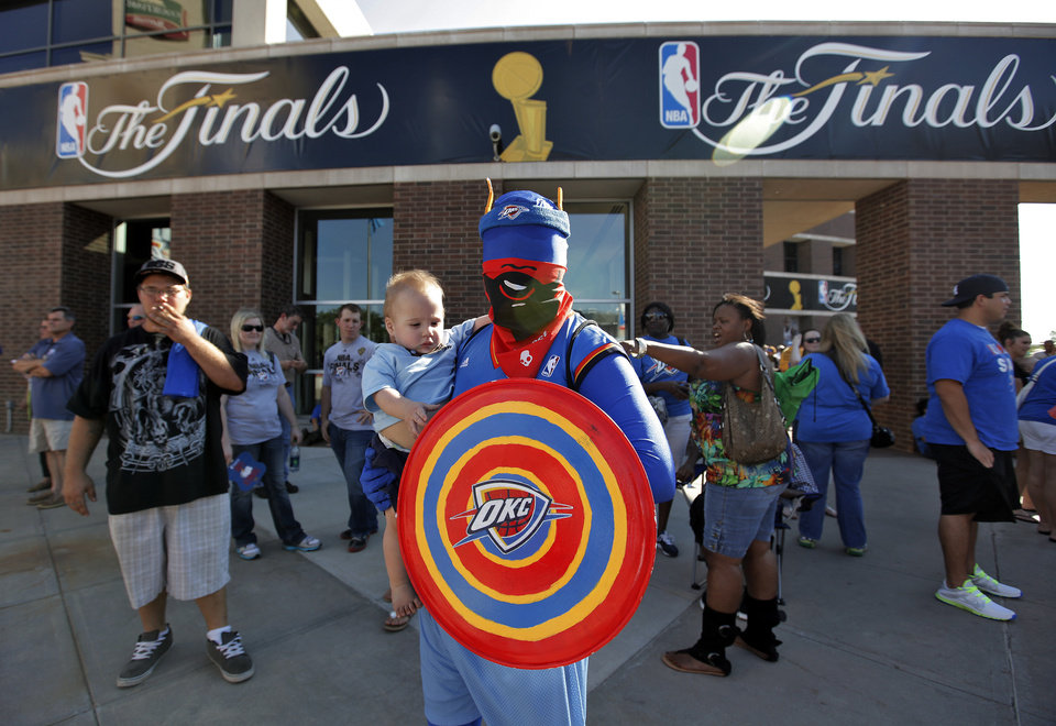 Cpt. Thunder poses for a photo with Thunder fan Kadence Guice, 12 months, before the start of Game 1 of the NBA Finals between the Oklahoma City Thunder and the Miami Heat at Chesapeake Energy Arena in Oklahoma City, Tuesday, June 12, 2012. Photo by Chris Landsberger, The Oklahoman