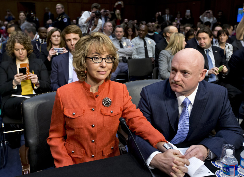 FILE - In this Jan. 30, 2013 file photo, former former U.S. Rep. Gabrielle Giffords, who survived a gunshot to the head in 2011, during a mass shooting in Tucson, Ariz., sits ready with her husband, retired astronaut Mark Kelly, at a Senate Judiciary Committee hearing on Capitol Hill in Washington to discuss legislation to curb gun violence. Giffords and Kelly are scheduled to be in Denver, Monday, March 4, 2013 to testify in support of at least one of the seven gun-control bills being considered by the Colorado Legislature. Eileen McCarron, president of the Colorado Ceasefire Capitol Fund, says Kelly will speak in support of a House bill that requires all private gun sales and transfers to be subject to a background check. (AP Photo/J. Scott Applewhite, File)