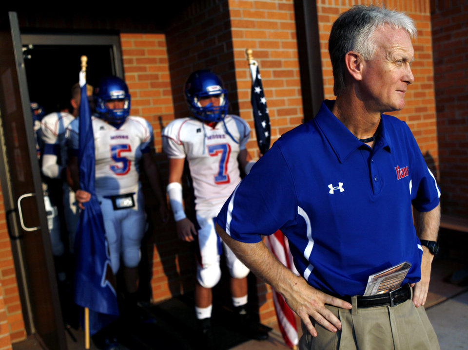 Photo - Moore coach Scott Myers waits with his team to take the field against Westmoore during their high school football game at Moore Stadium in Moore, Oklahoma on Friday, September 2, 2011. Photo by John Clanton, The Oklahoman