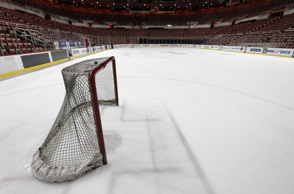 Photo - In this photo taken Tuesday, Dec. 18, 2012, a hockey goal sits on the ice at Joe Louis Arena home of the Detroit Red Wings hockey club in Detroit. The NHL lockout that's already wiped out the first three months of the season is taking its toll on small businesses in many of the NHL's markets. (AP Photo/Paul Sancya, File)