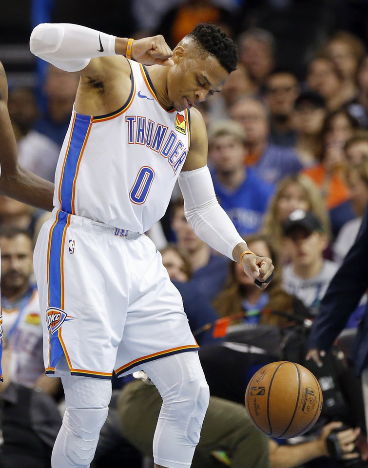 Photo - Oklahoma City's Russell Westbrook (0) pulls his right hand back to hit the ball at the end of the second quarter during an NBA basketball game between the Los Angeles Lakers and the Oklahoma City Thunder at Chesapeake Energy Arena in Oklahoma City, Tuesday, April 2, 2019. Photo by Nate Billings, The Oklahoman