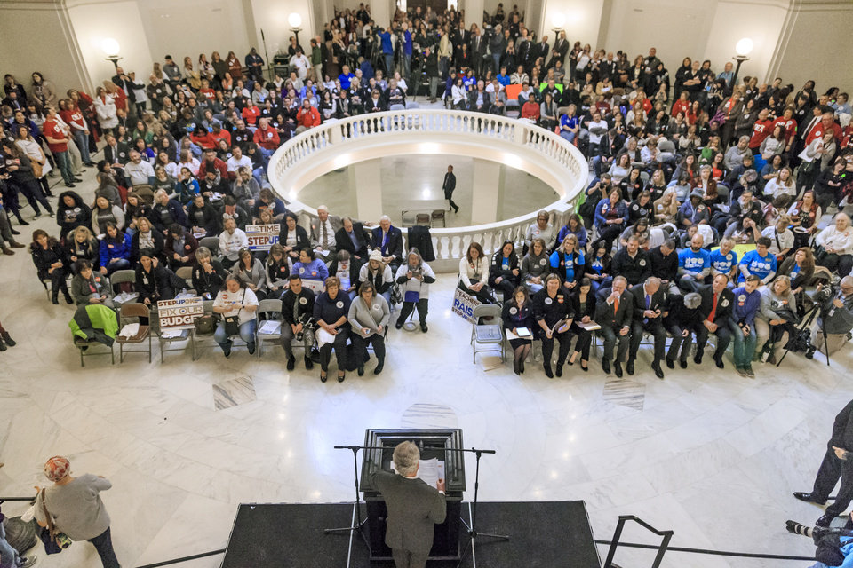 Photo -  Hundreds of advocates packed the Oklahoma Capitol rotunda on Monday in support of the Step Up Oklahoma plan. The rally drew teachers, business leaders and others who lobbied their state representatives to vote for the plan's key component. [Photo by Chris Landsberger, The Oklahoman]