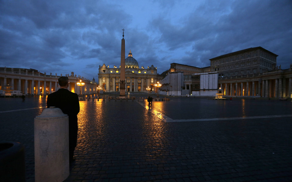 Photo - A man stands in St. Peter's Square at the Vatican, early Tuesday, Feb. 12, 2013. Declaring that he lacks the strength to do his job, Pope Benedict XVI announced Monday, Feb. 11, 2013 he will resign Feb. 28, becoming the first pontiff to step down in 600 years. His decision sets the stage for a mid-March conclave to elect a new leader for a Roman Catholic Church in deep turmoil. (AP Photo/Alessandra Tarantino)