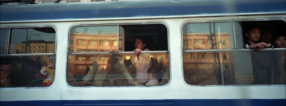 In this April 17, 2012 photo, North Korean commuters ride on a trolley car in central Pyongyang. (AP Photo/David Guttenfelder)