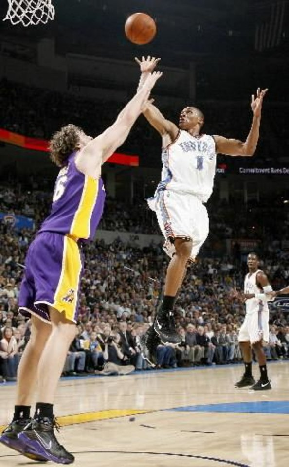 Photo - Oklahoma City's  Russell  Westbrook shots over Pau Gasol of the Lakers during the NBA basketball game between the Los Angeles Lakers and the Oklahoma City Thunder at the Ford Center, Tuesday, Feb. 24, 2009. PHOTO BY BRYAN TERRY
