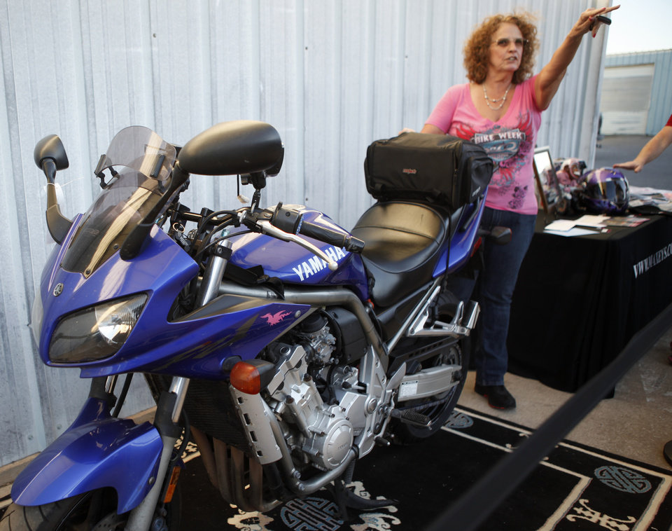 Denise Dickenson stands by her Yamaha FZ1 at Maxey's Cycles in Oklahoma CIty, Saturday, March 24, 2012. Maxey's Cycles hosted a party in honor of Denise Dickenson after she recently passed the 200,000 mile mark on her Yamaha FZ1. Photo by Bryan Terry, The Oklahoman