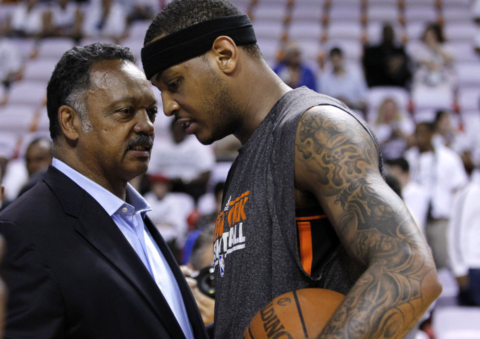 Photo -   The Rev. Jesse Jackson, left, talks with New York Knicks' Carmelo Anthony, right, before an NBA basketball game against the Miami Heat in the first round of the Eastern Conference playoffs in Miami, Monday, April 30, 2012. (AP Photo/Lynne Sladky)