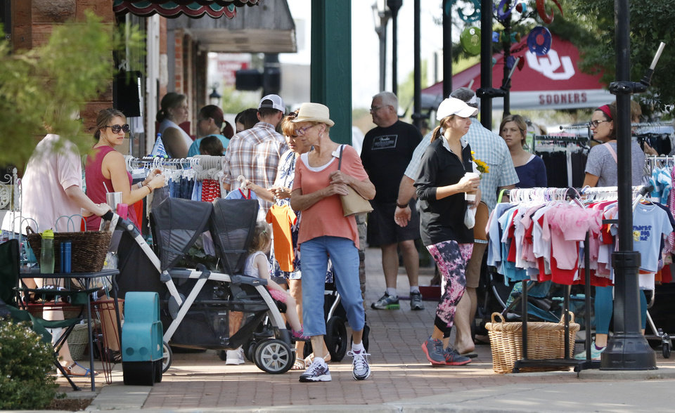 Photo -  Shoppers search through racks of clothing during Krazy Daze in downtown Edmond. [PHOTO BY PAUL HELLSTERN, THE OKLAHOMAN]