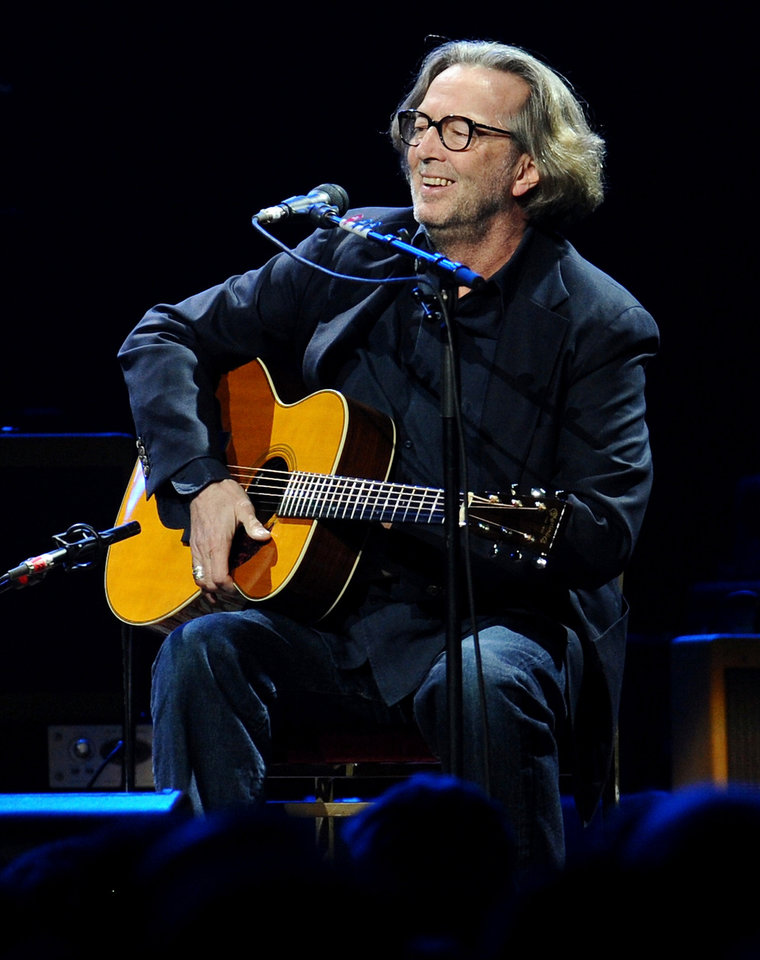 Photo - Guitarist Eric Clapton performs in concert at Madison Square Garden on Thursday, Feb. 18, 2010 in New York. (AP Photo/Evan Agostini)  ORG XMIT: NYEA108