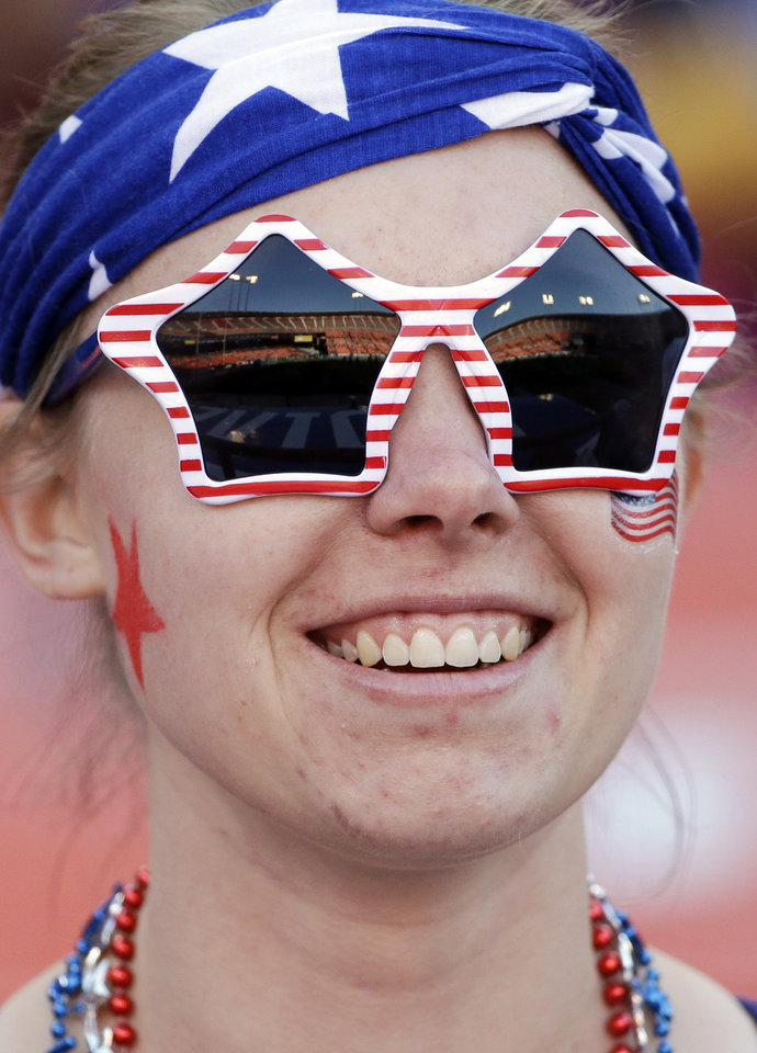 Photo - A fan wears glasses as she waits for the start of an international friendly soccer match between the United States and Azerbaijan on Tuesday, May 27, 2014, in San Francisco. (AP Photo/Marcio Jose Sanchez)