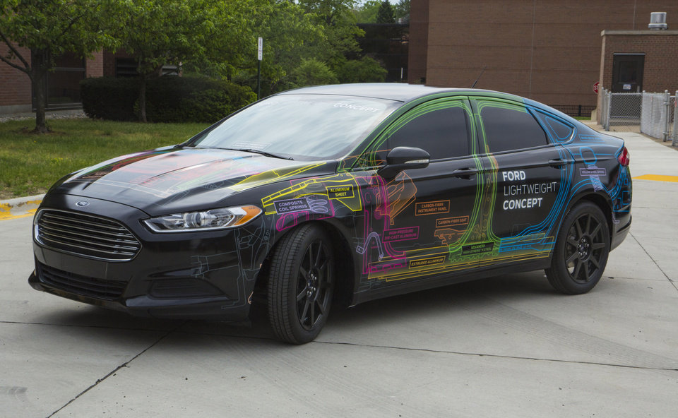 Photo - This undated photo provided by Ford Motor Co. shows a lightweight Fusion sedan that was unveiled Tuesday, June 3, 3014. The prototype is 800 pounds lighter than a regular Fusion thanks to more use of aluminum and other materials. (AP Photo/Ford Motor Co.)