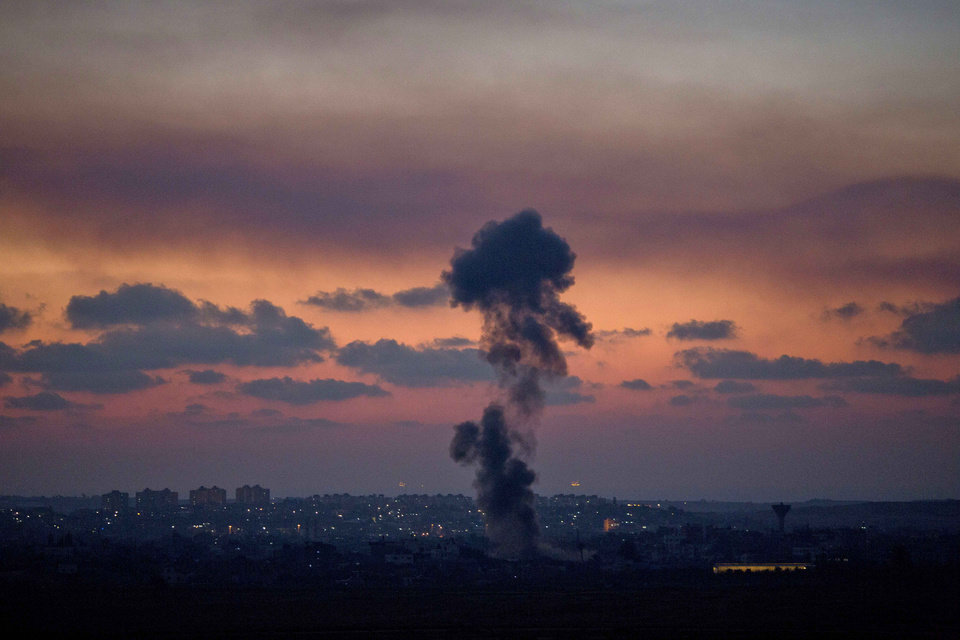 Photo - Smoke rises following an Israeli strike on Gaza, as seen from the Israel-Gaza Border, Tuesday, July 8, 2014. The Israeli military launched a major offensive in the Hamas-ruled Gaza Strip on Tuesday, striking more than 100 sites and mobilizing troops for a possible ground invasion in what Israel says is an operation aimed at stopping a heavy barrage of rocket attacks from the Palestinian territory.(AP Photo/Ariel Schalit)