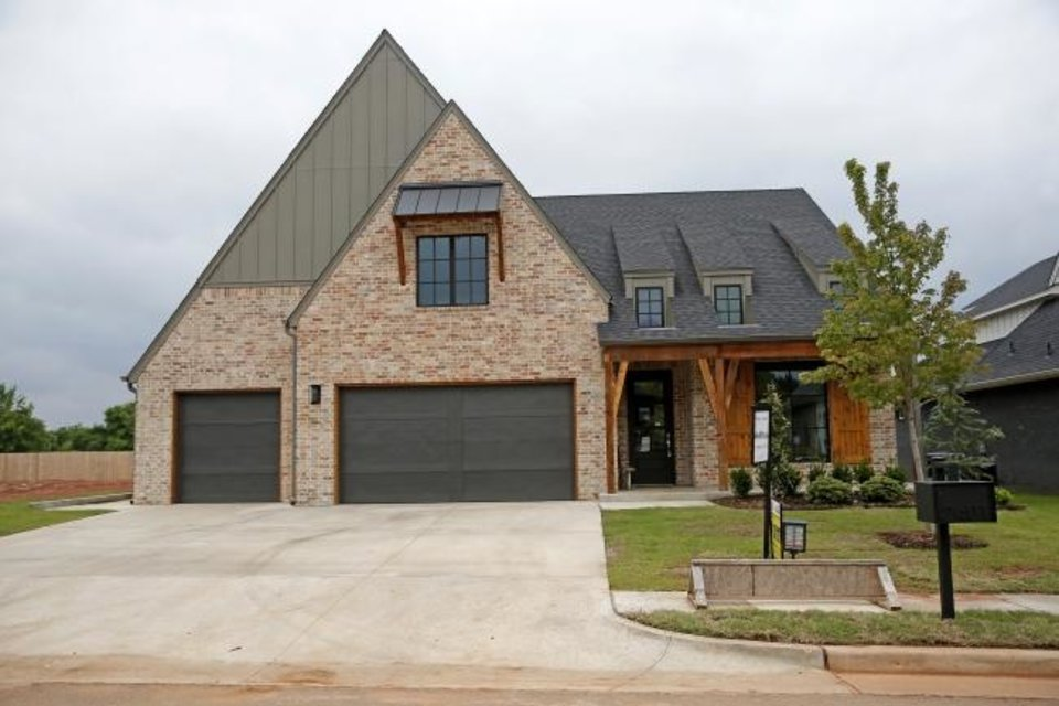 Photo -  Ripple Creek Homes LLC built this four-bedroom, four-bath, 3,075-square-foot Urban Farmhouse-style house at 2401 Amante Court, Edmond, for the Parade of Homes Spring Festival. The home, in the Cross Timbers addition on Covell Road between Sooner and Coltrane, is on offer for $545,000.  [SARAH PHIPPS/THE OKLAHOMAN]