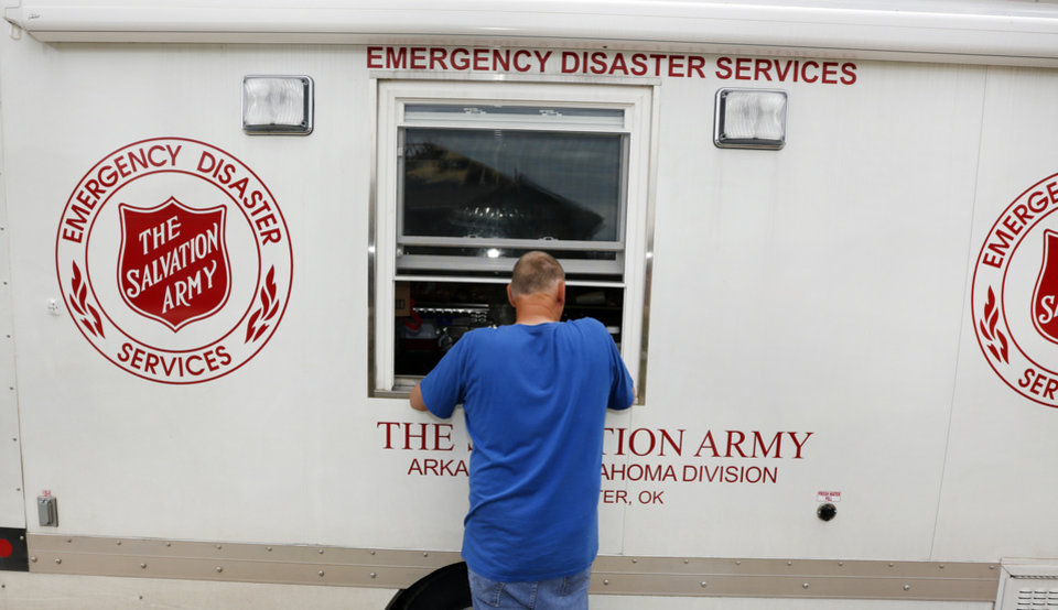 Ken Wedel gets lunch from the Salvation Army in Oklahoma City, Thursday May 23, 2013. Ken\'s home on Sylena Way was damaged by the massive tornado that hit Monday.Photo By Steve Gooch, The Oklahoman