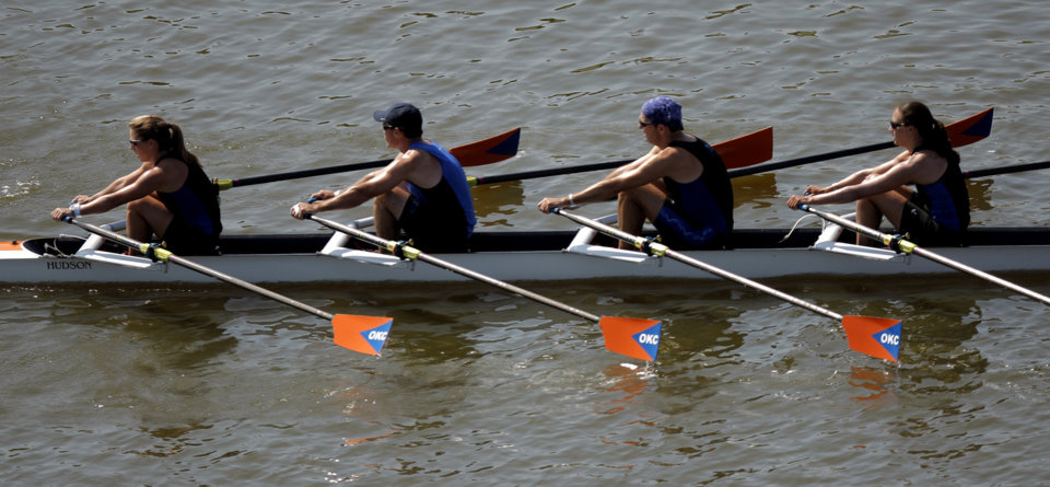 Photo - The Austin Rowing Club competes in the Mixed A 4x final during the USRowing Masters National Championships on the Oklahoma River, Sunday, Aug. 14, 2011. Photo by Sarah Phipps, The Oklahoman
