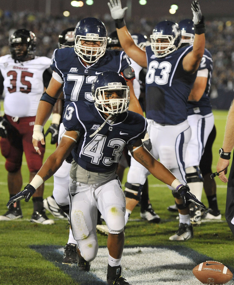 Photo -   Connecticut's Lyle McCombs (43) celebrates his touchdown against Massachusetts in the first half of an NCAA college football game in East Hartford, Conn., Thursday, Aug. 30, 2012. (AP Photo/Jessica Hill)