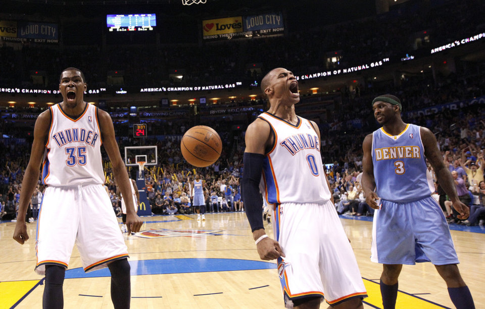 Photo - Oklahoma City's Kevin Durant (35) and Oklahoma City's Russell Westbrook (0) celebrate in front of Denver's Ty Lawson (3) during the NBA basketball game between the Oklahoma City Thunder and the Denver Nuggets, Friday, April 8, 2011, at the Oklahoma City Arena. Photo by Sarah Phipps, The Oklahoman