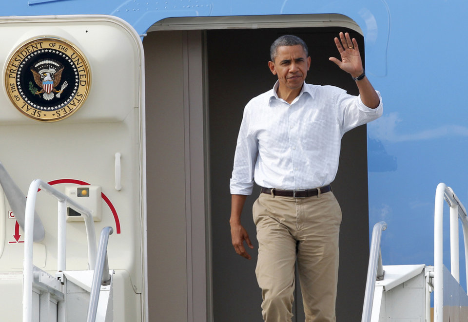 <p>President Barack Obama waves as he arrives at Louis Armstrong New Orleans International Airport in Kenner, La., Monday, Sept. 3, 2012. (AP Photo/Jonathan Bachman)</p>