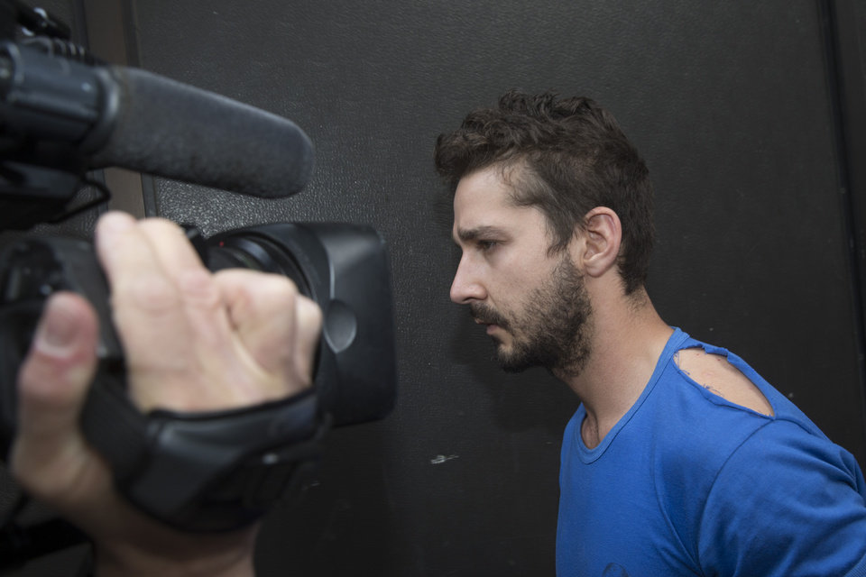 Photo - Actor Shia LaBeouf is followed by media after leaving Midtown Community Court following his arrest the previous day for yelling obscenities the Broadway show