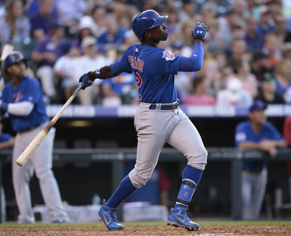 Chicago Cubs' Alfonso Soriano watches his solo home run against the Colorado Rockies in the fourth inning of a baseball game in Denver, Friday, July 19, 2013. (AP Photo/Joe Mahoney)