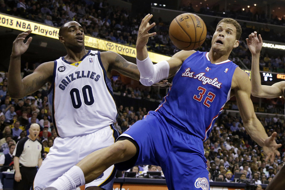 Photo - Los Angeles Clippers' Blake Griffin (32) reaches for a rebound in front of Memphis Grizzlies' Darrell Arthur (00) during the first half of Game 6 in a first-round NBA basketball playoff series in Memphis, Tenn., Friday, May 3, 2013. (AP Photo/Danny Johnston)