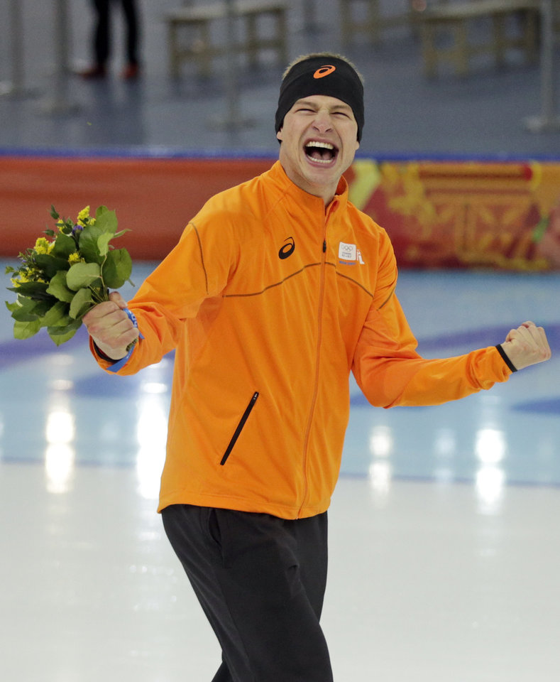 Photo - Sven Kramer of the Netherlands celebrates after winning the gold in the men's 5,000-meter speedskating race at the Adler Arena Skating Center at the 2014 Winter Olympics in Sochi, Russia, Saturday, Feb. 8, 2014. (AP Photo/Matt Dunham)