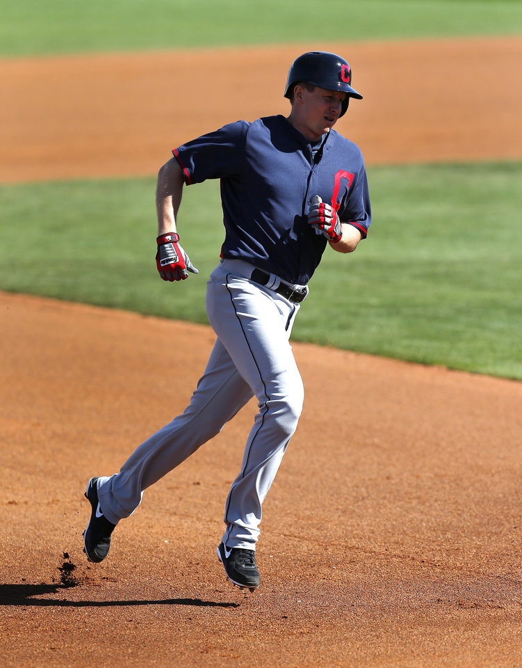 Photo - Cleveland Indians' Elliot Johnson rounds the bases after hitting a two-run home run against the Cincinnati Reds in the fourth inning of an exhibition baseball game in Goodyear, Ariz., Thursday, Feb. 27, 2014. (AP Photo/Paul Sancya)