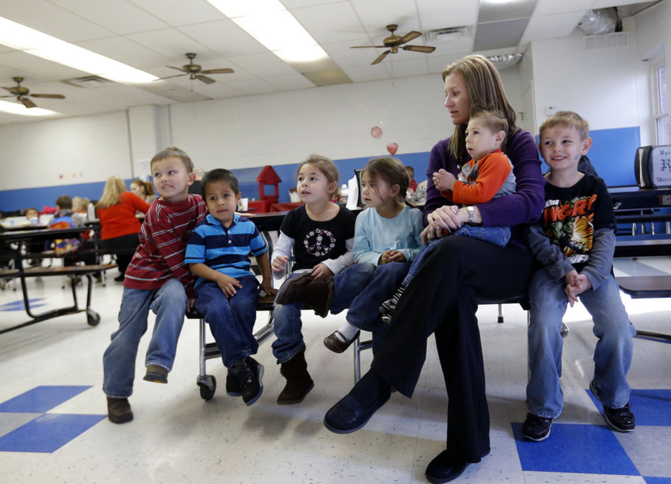 Photo - CHILD / CHILDREN / KIDS: Kary Trent waits with her students before they leave the cafeteria at Ryal Public School, Wednesday, Feb. 13, 2013. Photo by Sarah Phipps, The Oklahoman
