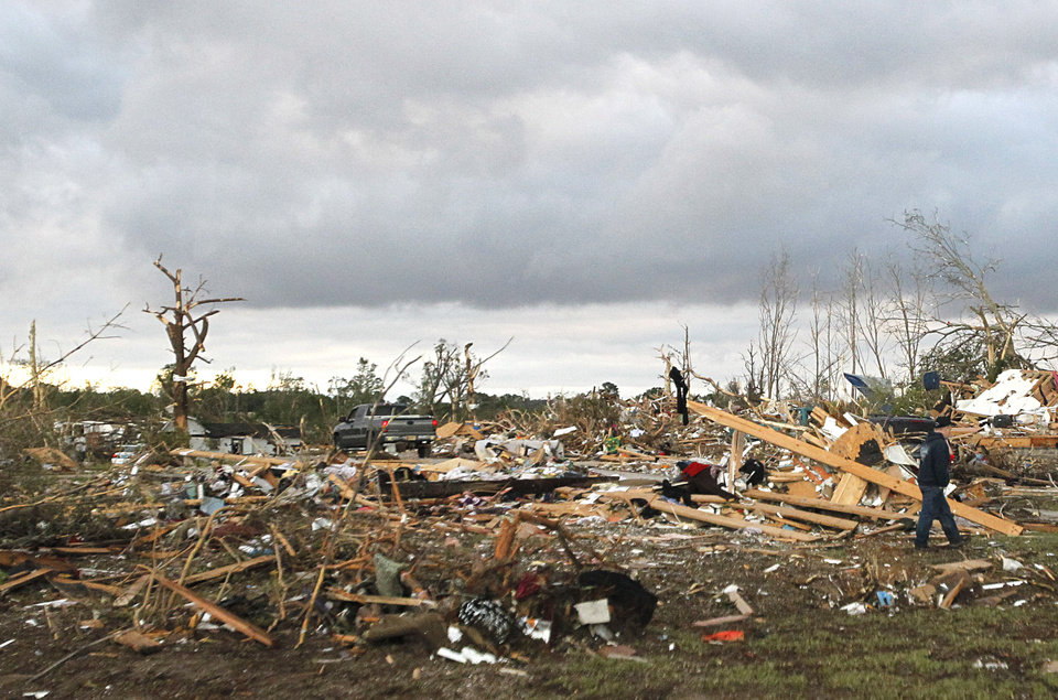 Photo - Residents search through what is left of their homes Thursday April 28, 2011 after a tornado hit Pleasant Grove, Ala., just west of downtown Birmingham Wednesday afternoon. (AP Photo/Butch Dill)