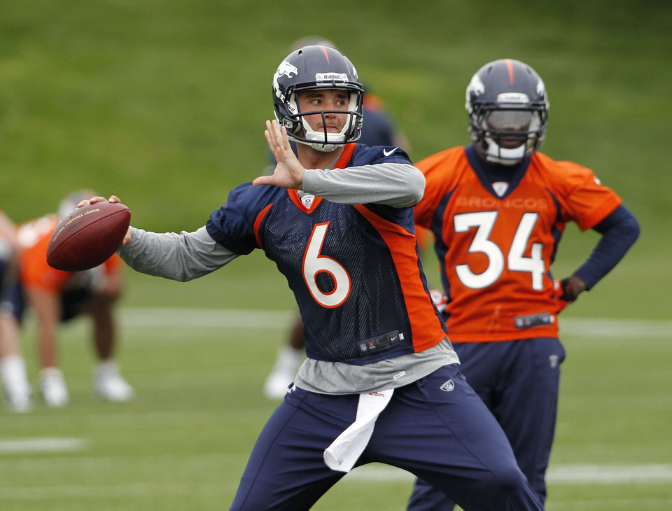 Photo -   Rookie quarterback Brock Osweiler (6) sets to throw a pass during the Denver Broncos NFL football rookie minicamp at the team's training facility in Englewood, Colo., on Friday, May 11, 2012. Running back Ronnie Hillman (34) looks on at right. (AP Photo/Ed Andrieski)