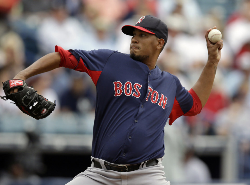 Boston Red Sox starting pitcher Felix Doubront winds up in the first inning of a spring training baseball game against the New York Yankees in Tampa, Fla., Wednesday, March 20, 2013.  (AP Photo/Kathy Willens)