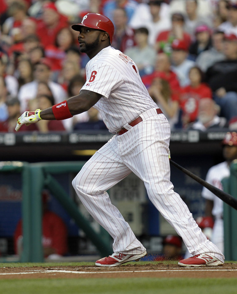 Photo - Philadelphia Phillies' Ryan Howard follows through on a home run in the first inning of a baseball game against the Washington Nationals, Saturday, May 3, 2014, in Philadelphia. (AP Photo/Laurence Kesterson)