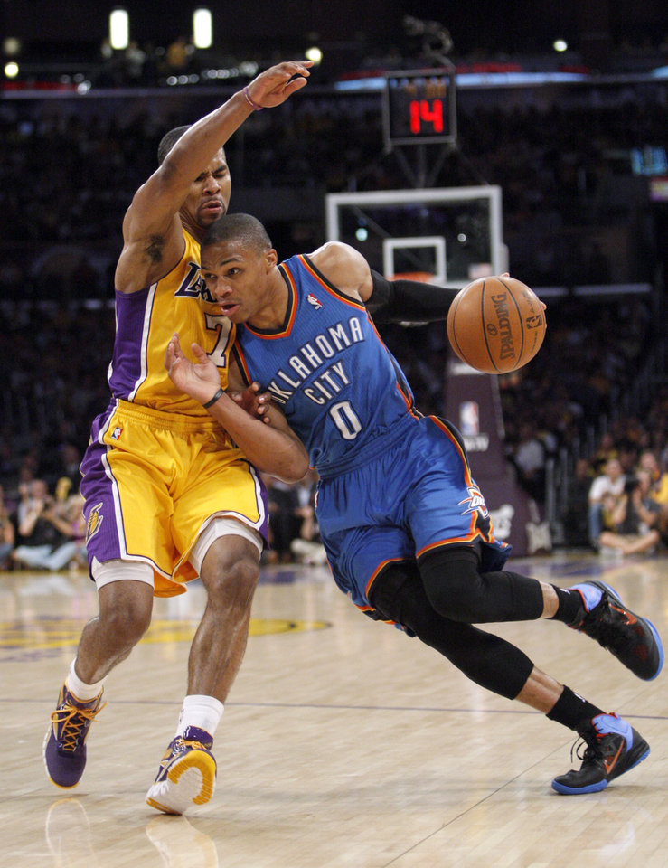 LOS ANGELES LAKERS: Oklahoma City's Russell Westbrook (0) drives past Los Angeles' Ramon Sessions (7) during Game 4 in the second round of the NBA basketball playoffs between the L.A. Lakers and the Oklahoma City Thunder at the Staples Center in Los Angeles, Saturday, May 19, 2012. Photo by Nate Billings, The Oklahoman