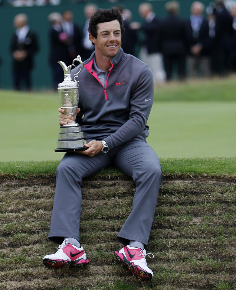 Photo - Rory McIlroy of Northern Ireland holds the Claret Jug trophy after winning the British Open Golf championship at the Royal Liverpool golf club, Hoylake, England, Sunday July 20, 2014. (AP Photo/Peter Morrison)