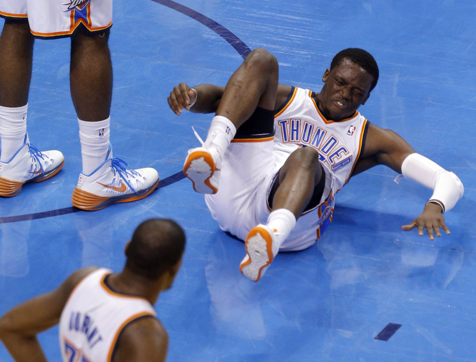 Photo - Oklahoma City's Reggie Jackson (15) reacts after injuring his ankle during Game 4 of the Western Conference Finals in the NBA playoffs between the Oklahoma City Thunder and the San Antonio Spurs at Chesapeake Energy Arena in Oklahoma City, Tuesday, May 27, 2014. Photo by Bryan Terry, The Oklahoman
