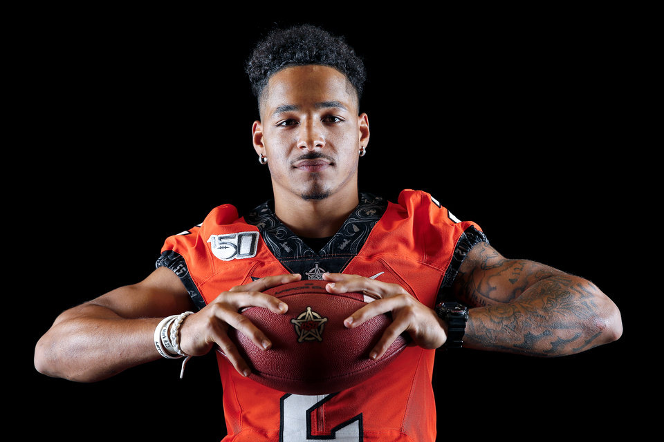 Photo - OSU's Tylan Wallaces poses for a photo during the Oklahoma State Cowboys football media days at Gallagher-Iba Arena in Stillwater, Okla., Saturday, Aug. 3, 2019. [Sarah Phipps/The Oklahoman]