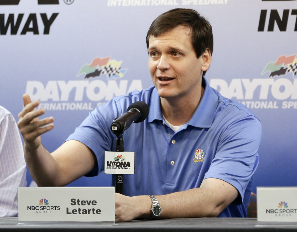Photo - NASCAR crew chief Steve Latarte answers question during a news conference at Sprint Cup auto racing testing at Daytona International Speedway in Daytona Beach, Fla., Friday, Jan. 10, 2014. Latarte will join NBC Sports in 2015 as a commentator.(AP Photo/John Raoux)