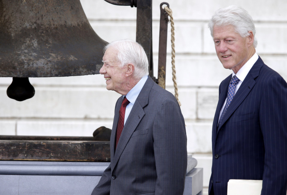 Former Presidents Jimmy Carter and Bill Clinton arrive at the Let Freedom Ring ceremony at the Lincoln Memorial in Washington, Wednesday, Aug. 28, 2013, to commemorate the 50th anniversary of the 1963 March on Washington for Jobs and Freedom. It was 50 years ago today when Martin Luther King Jr. delivered his