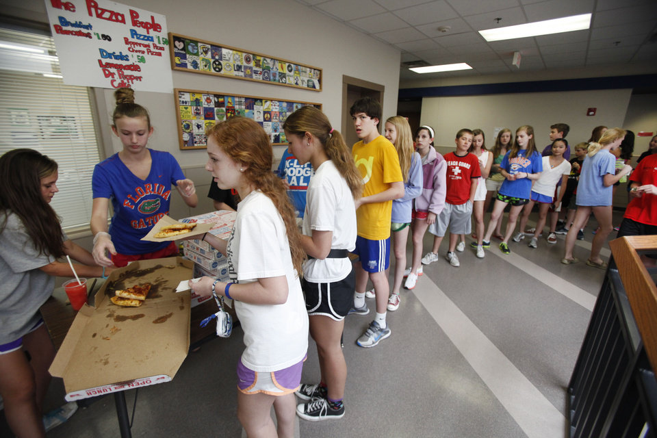 Photo - Westminster School students wait in line to purchase pizza during lunch hour Tuesday in Oklahoma City. Photo By Steve Gooch, The Oklahoman