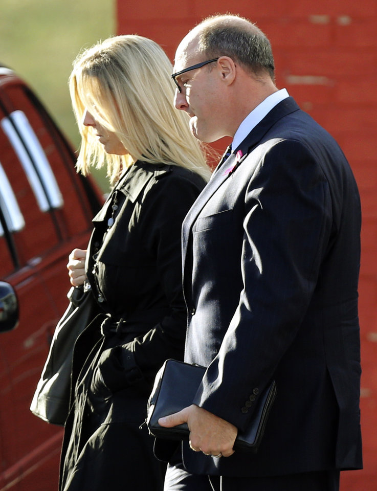 Photo - Kansas City Chiefs general manager Scott Pioli, right, leaves a memorial service for Jovan Belcher at the Landmark International Deliverance and Worship Center, Wednesday, Dec. 5, 2012, in Kansas City, Mo. Belcher shot his girlfriend, Kasandra Perkins, at their home Saturday morning before driving to Arrowhead Stadium and turning the gun on himself. (AP Photo/Ed Zurga)