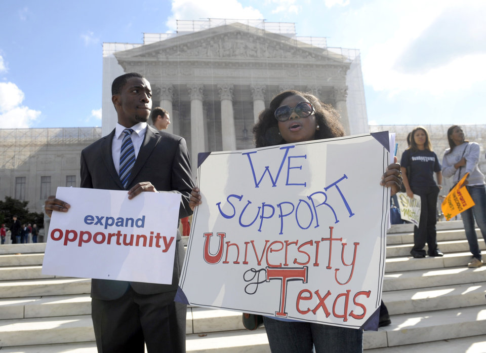 Jheanelle Wilkins of New Castle, Del., right, and Neo Moneri of Beltsville, Md., participate in a rally outside the Supreme Court in Washington, Wednesday, Oct. 10, 2012, supporting the University of Texas.. The Supreme Court is taking up a challenge to a University of Texas program that considers race in some college admissions. The case could produce new limits on affirmative action at universities, or roll it back entirely. (AP Photo/Susan Walsh)