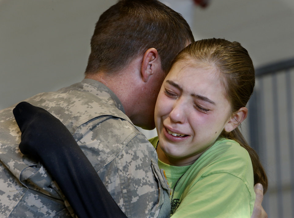 Sgt. Ron Elwell, Mustang, hugs daughter Katrina, 15, at a deployment ceremony for 149th General Support Aviation Battalion (GSAB), as they prepare for deployment to Afghanistan in support of Operation Enduring Freedom on Thursday, April 25, 2013 in Lexington, Okla.  Photo by Steve Sisney, The Oklahoman
