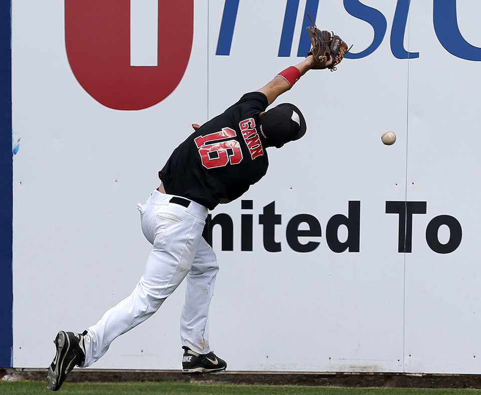 Caney Valley 's Abram Gann misses the ball against Silo in the third inning of a Class 2A state baseball tournament game in Shawnee, Okla., Friday, May 10, 2013. Photo by Bryan Terry, The Oklahoman