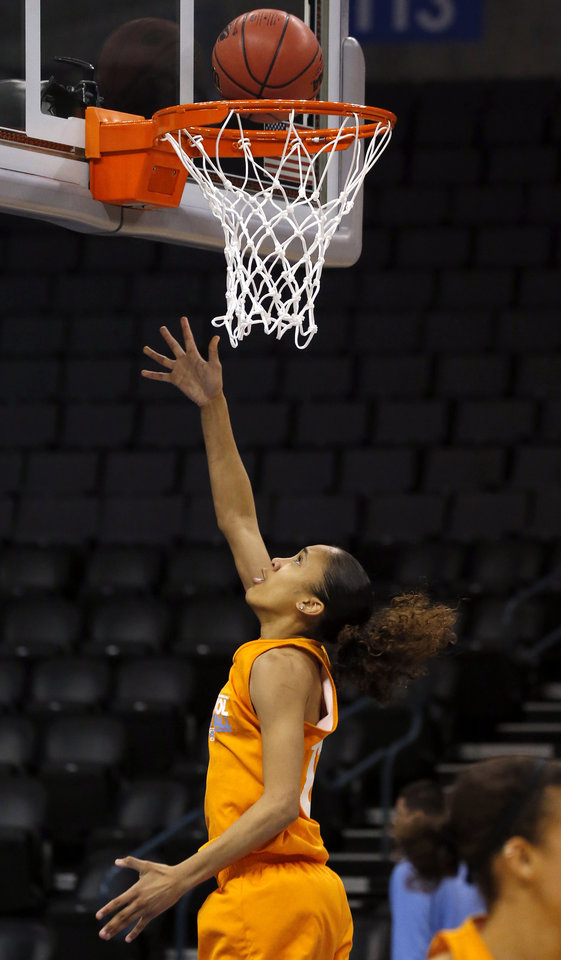 Photo - Tennesse guard Meighan Simmons (10) shoots a lay up during the press conference and practice day at the Oklahoma City Regional for the NCAA women's college basketball tournament at Chesapeake Arena in Oklahoma City, Friday, March 29, 2013. Photo by Sarah Phipps, The Oklahoman