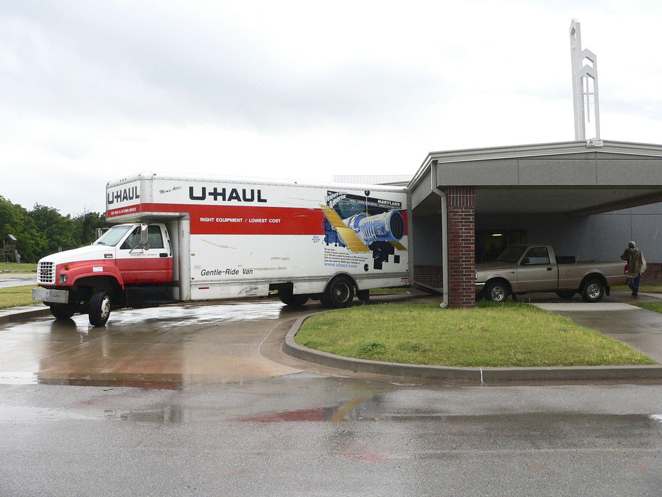 Photo - A moving truck sits outside the church building at 100 S Choctaw Road in Choctaw during a church property swap in late May. Photo provided